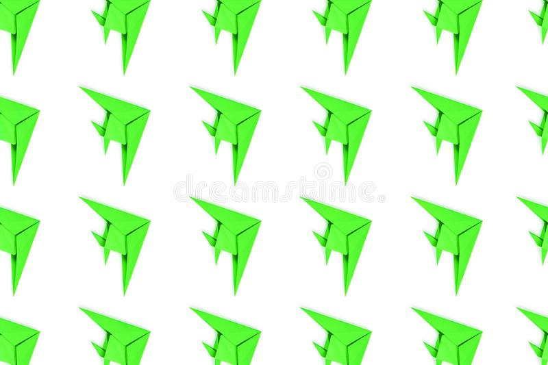 Paper origami fishes isolated on white background. Pattern of neon paper origami fishes isolated on white background stock photos