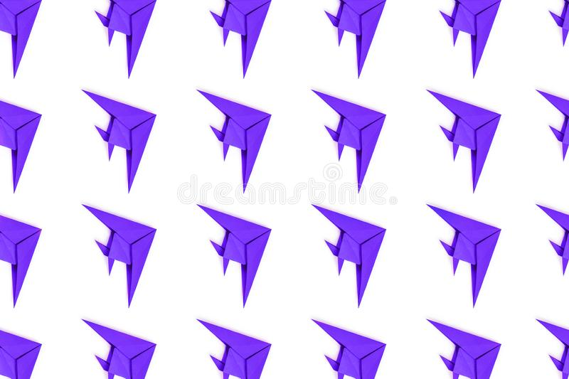 Paper origami fishes isolated on white background. Pattern of puprle paper origami fishes isolated on white background stock photography