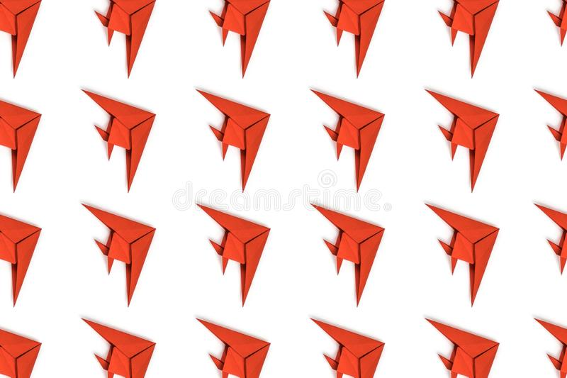 Paper origami fishes isolated on white background. Pattern of red paper origami fishes isolated on white background stock photo