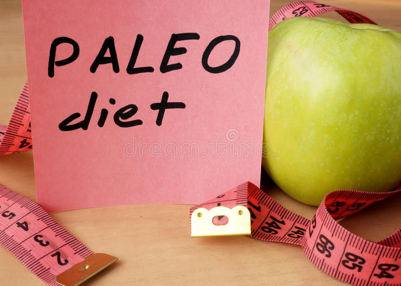 Paper with paleo diet, apple and measuring tape. stock photography