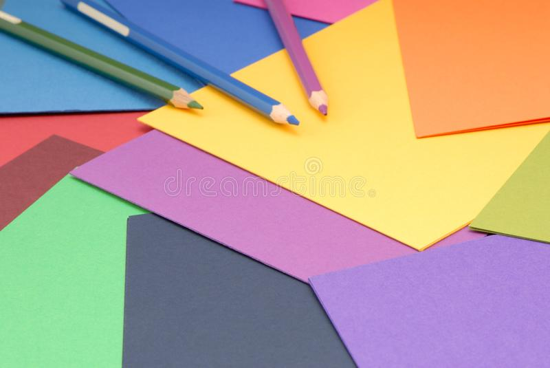 paper and pencils for artwork, color palette of paper, multicoloured paper background, multicolour paper and coloured pencils stock photos