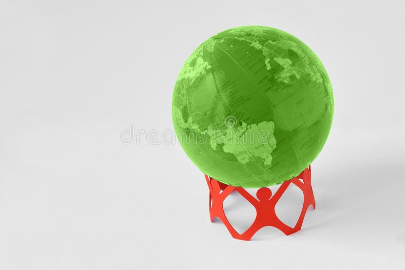 Paper people in a circle holding green earth globe - Ecology con. Paper people in a circle holding green earth globe on white background - Ecology concept stock images