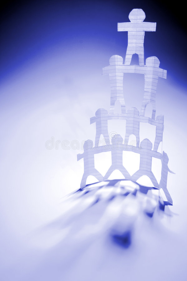 Paper People Pyramid. Paper cutouts of a pyramid of stick figures, on blue and white background. Conceptual stock photo