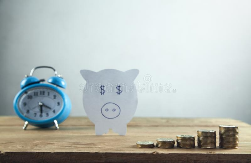 Paper piggy bank with stack of coins. Save your money royalty free stock images