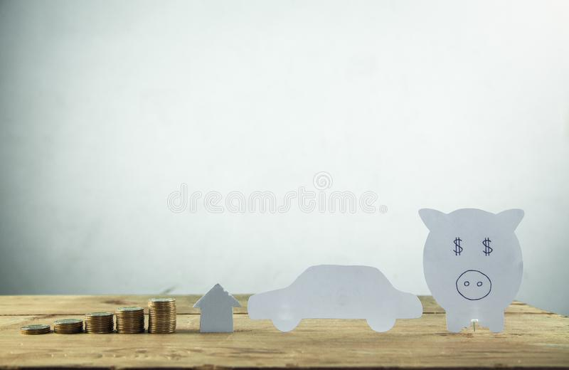 Paper piggy bank with stack of coins. Save your money stock image