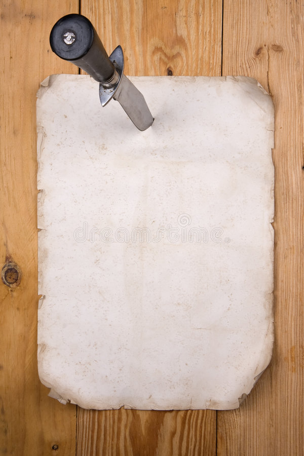 Paper pinned with a knife royalty free stock photography
