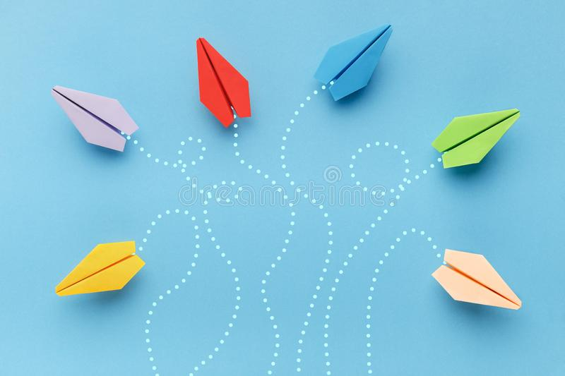 Paper planes with route trace on blue background stock images