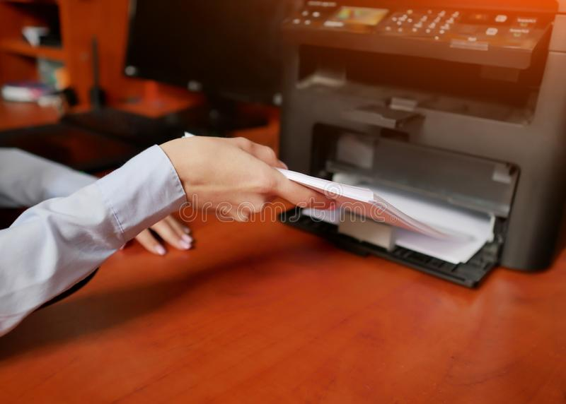 Paper in printer. sets the paper stack in the laser printer stock photos