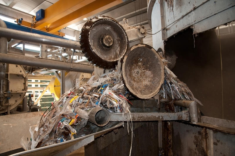 Paper and pulp mill - Pulping. This paper mill is a factory devoted to making paper and cardboard from recycled paper using this Fourdrinier Machine. This is a royalty free stock photo