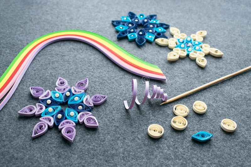 Paper quilling Christmas Crafts in the form of snowflakes from s royalty free stock photos