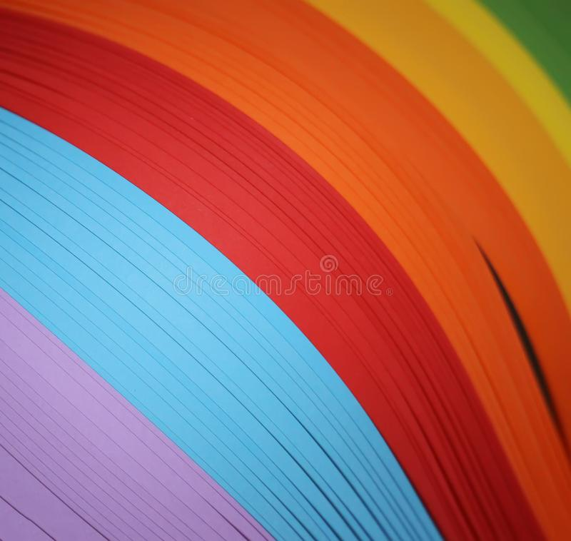Paper in rainbow color for quilling royalty free stock images
