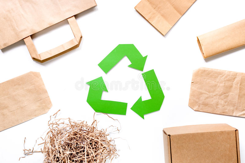Paper recycle sign with paper and carton garbage on white background top view.  stock photos