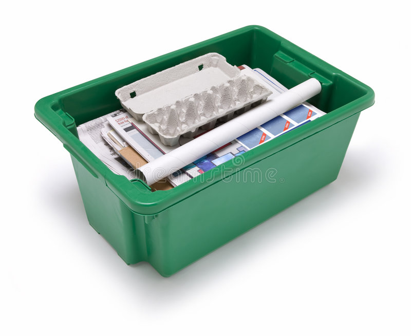 Paper Recycling. A green bin full of paper recycling stock photography