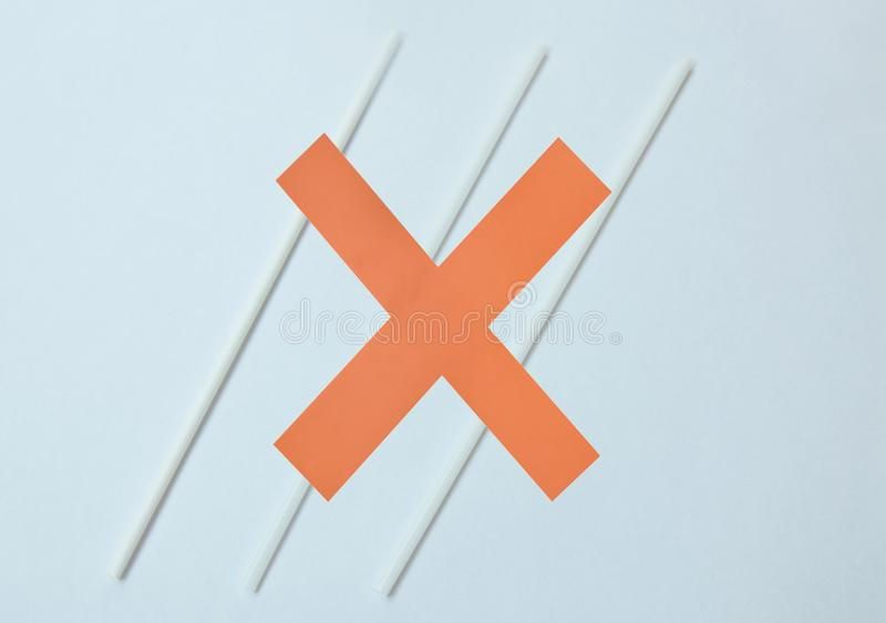 Paper red cross on white drinking straw campaign concept for reduce to used plastic royalty free stock images