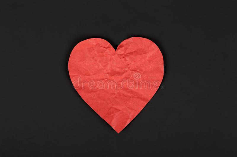 Paper red heart on a dark background. stock photo