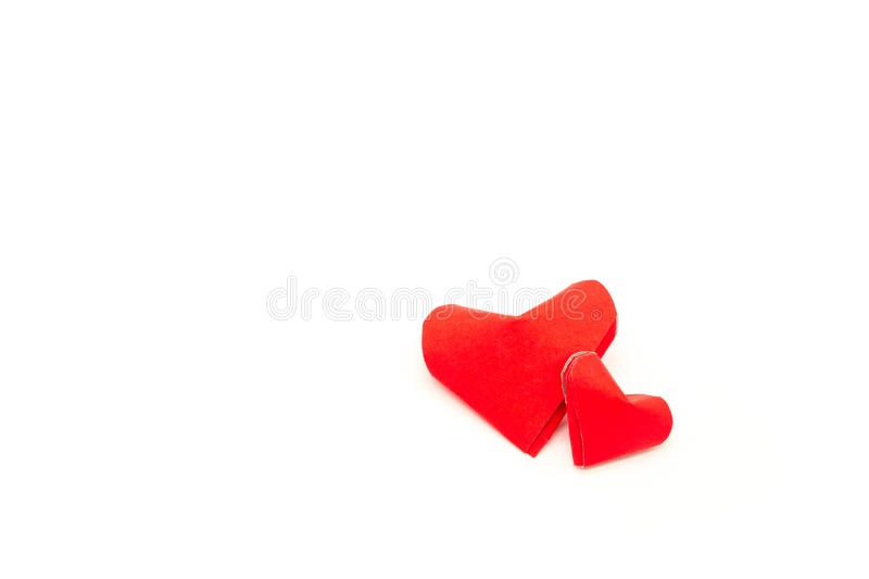 Paper red heart on white. In top view royalty free stock image