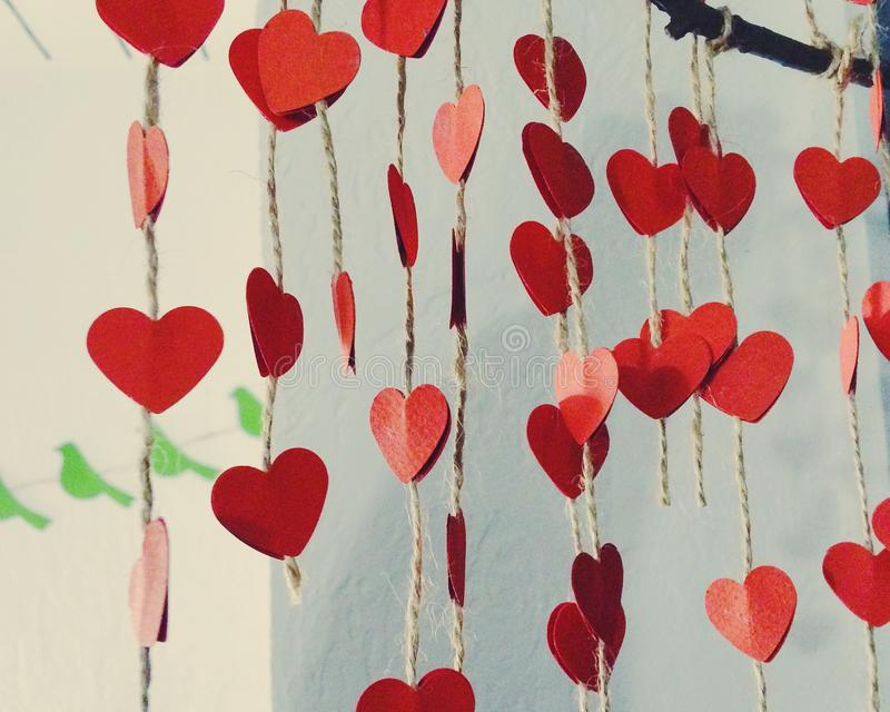 Paper red hearts on strings from hemp royalty free stock photos