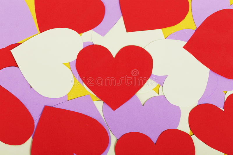 Paper red and purple hearts royalty free stock photography