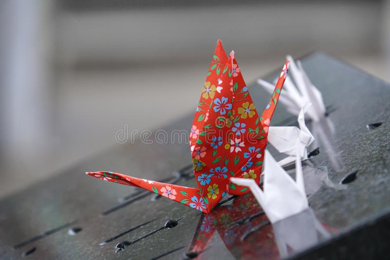 Paper red white bird origami. Paper red and white bird crane origami stock image