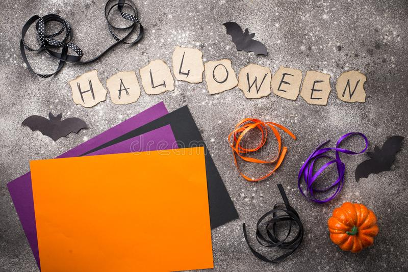 Paper and ribbon for Halloween DIY. Purple, orange and black paper and ribbon for Halloween DIY stock photo