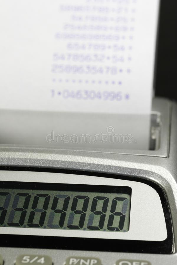 Paper roll of a desk-top calculator 02 royalty free stock photo