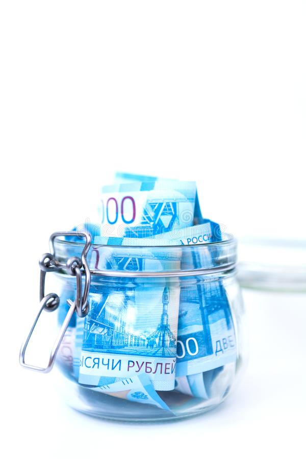 Paper Russian Money. New Russian Banknotes Of 2000 Two Thousands Rubles Close Up in glass jar on white isolated background. stock photography