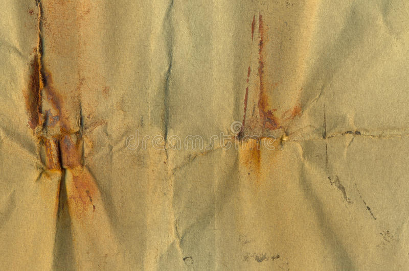 Paper with rust stains. Weathered piece of paper with rust stains. Abstract grunge background stock image