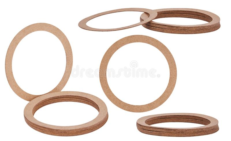 Paper Sealing rings gaskets, o-rings isolated on white background. Paper hydraulic and pneumatic o-ring seals. Paper rings. Sealing gaskets royalty free stock photo