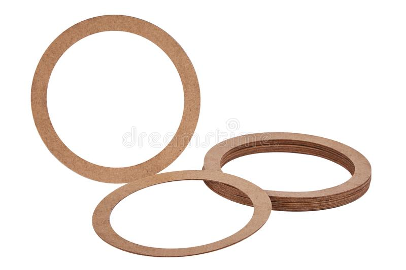 Paper Sealing rings gaskets, o-rings isolated on white background. Paper hydraulic and pneumatic o-ring seals. Paper rings. Sealing gaskets stock photos
