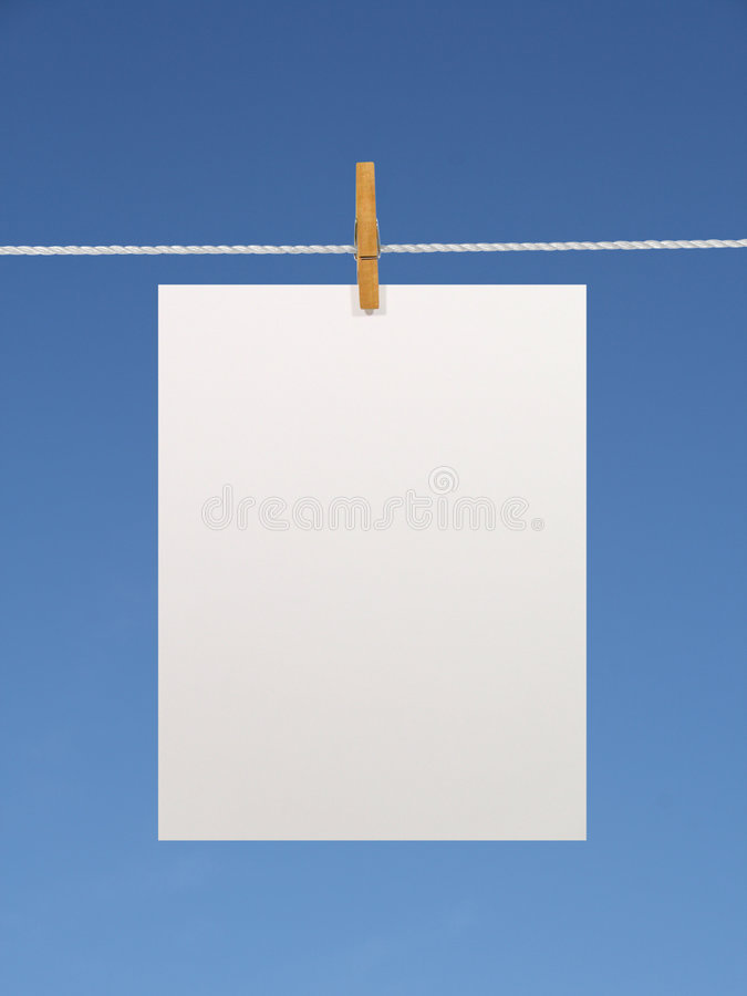 Paper sheet on a clothes line royalty free stock image