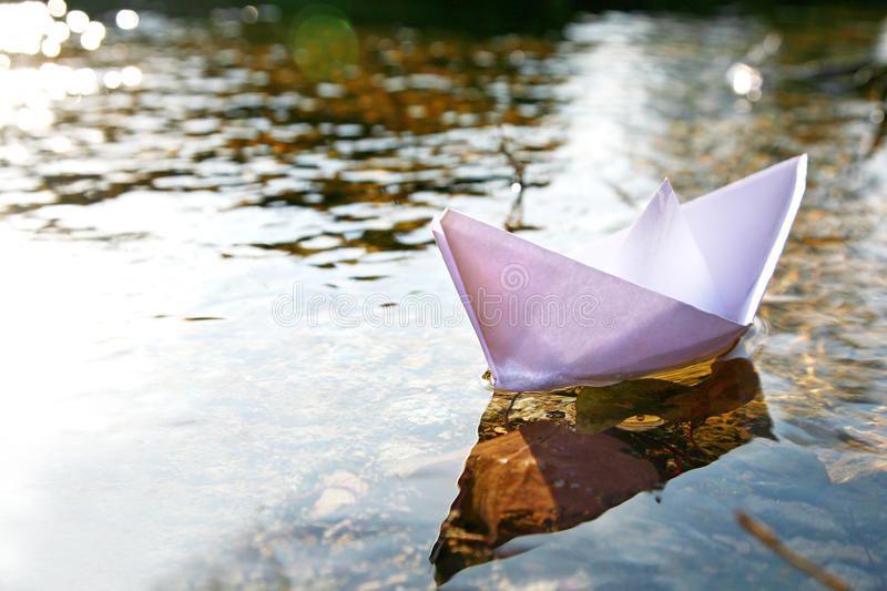 Paper ship in the lake royalty free stock photo