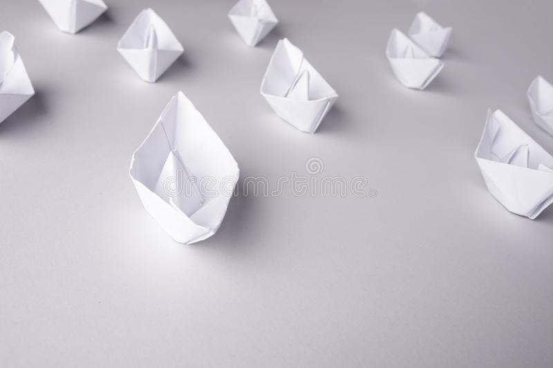 Paper ships on a white background. Place for text. Set of real photos on four paper ships, boat, origami, white, folded, background, cruise, sail, travel, fleet stock images