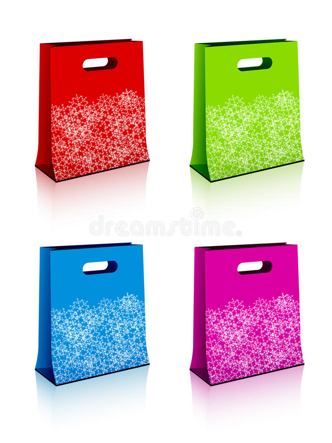 Paper Shopping Bags With Christmas Snowflakes Stock Image