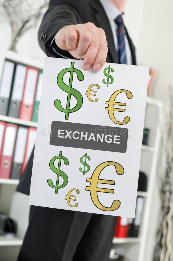 Exchange concept shown by a businessman. Paper showing exchange concept held by a businessman royalty free stock images
