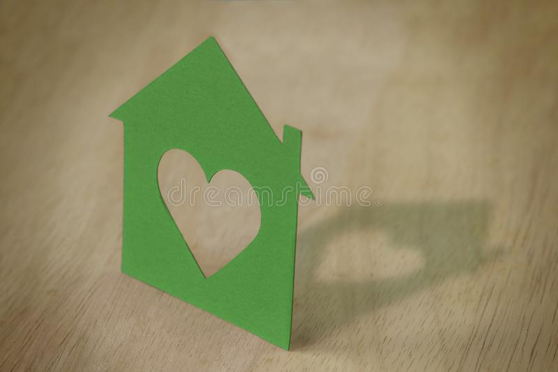 Paper silhouette of house - Ecology concept stock photo