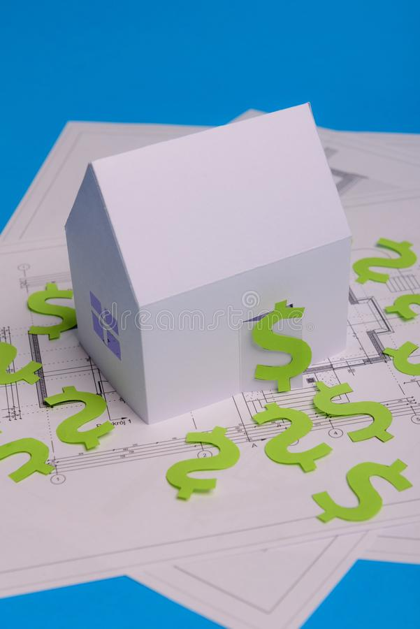 Paper skyscrapers , us dollar money, house projects plan and blueprints on blue background paper. Minimalistic and simple concept. Style. Horizontal stock photos