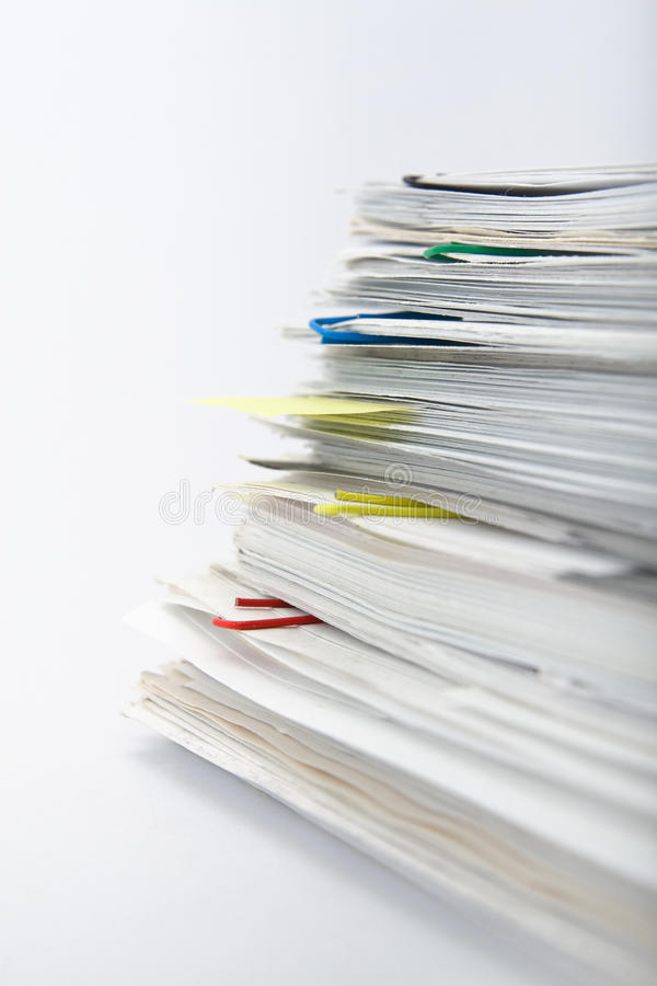 Paper stack on white background stock images