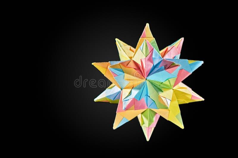 Paper star Kusudama traditional Japanese healing ball on grey background stock photo
