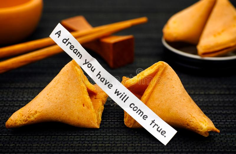 Paper strip with phrase A Dream You Have Will Come True from fortune cookie stock images