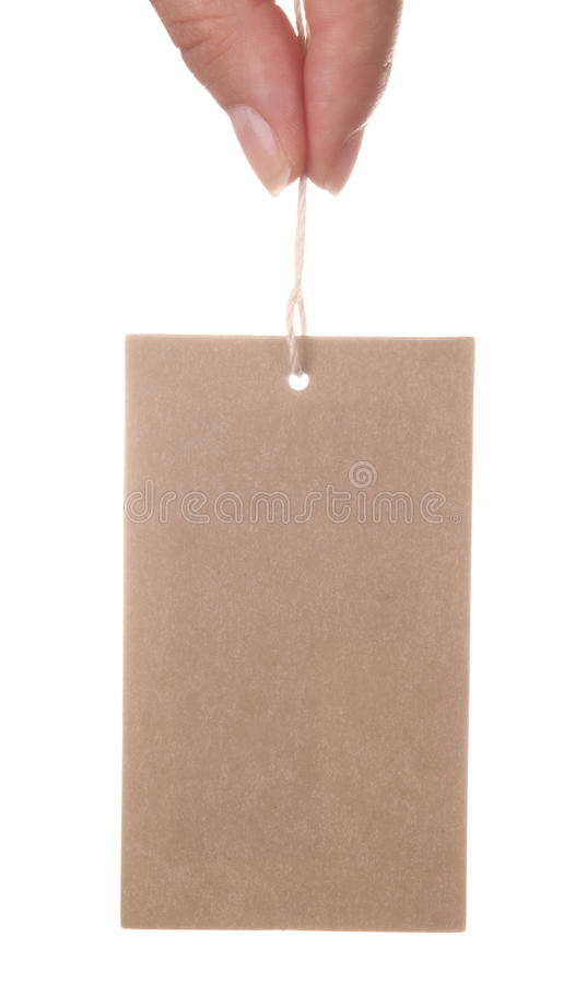 Paper tag and hand. Isolated on white background royalty free stock image