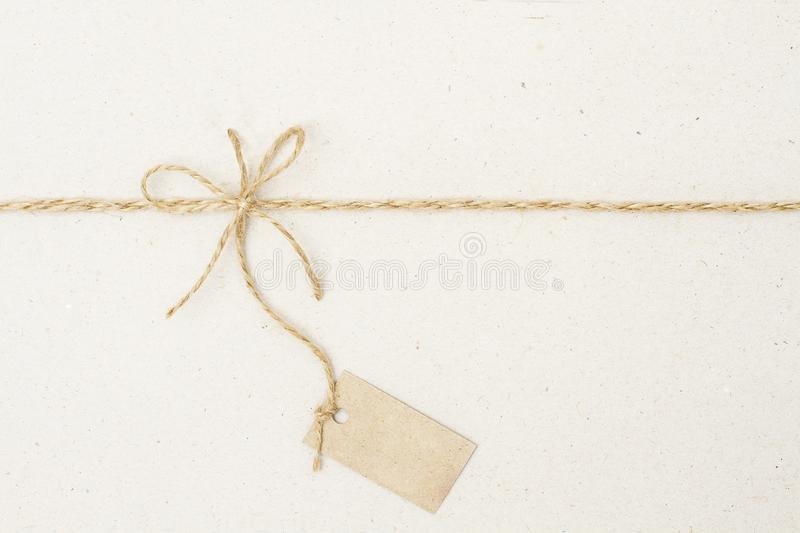 Paper Tag Label and Rope Bow, Present Pricing Decoration. With Natural Twine String royalty free stock image