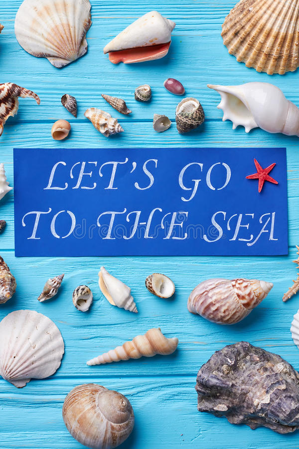 Paper with text, sea shells. Beautiful collection of natural marine objects from resort stock photo