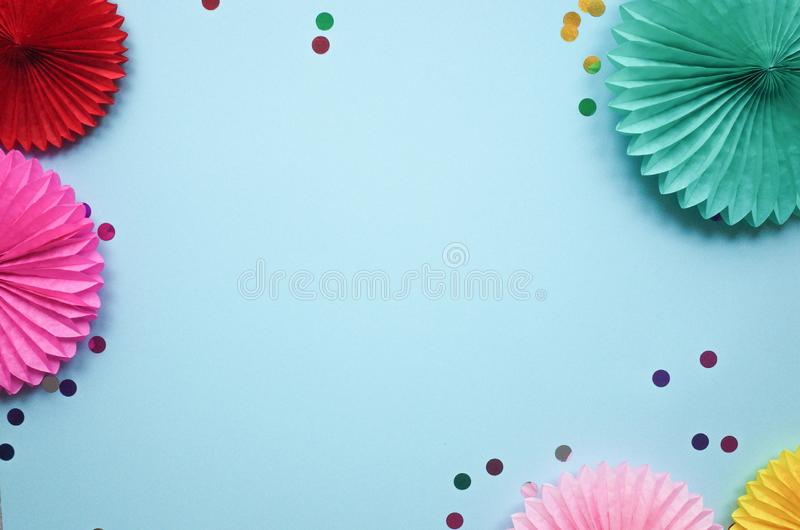 Paper texture flowers with confetti. Birthday, holiday or party background. Flat lay style. royalty free stock image