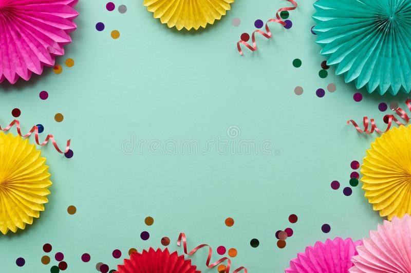 Paper texture flowers on green background. Birthday, holiday or party background. Flat lay style stock photos