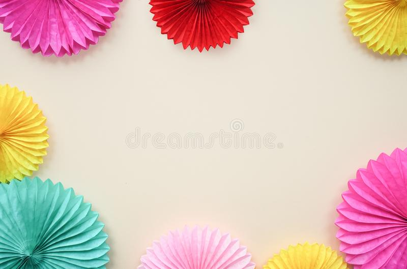 Paper texture flowers on light background. Birthday, holiday or party background. Flat lay style. stock photos