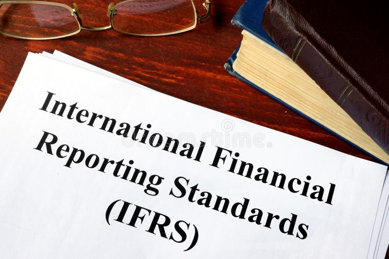 International Financial Reporting Standards IFRS. Paper with title International Financial Reporting Standards IFRS royalty free stock image