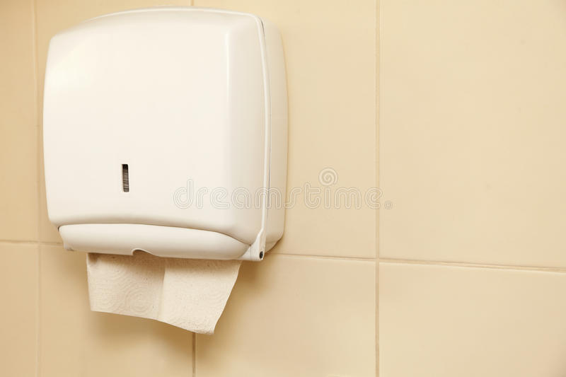 Paper towel dispenser in the bathroom stock photos