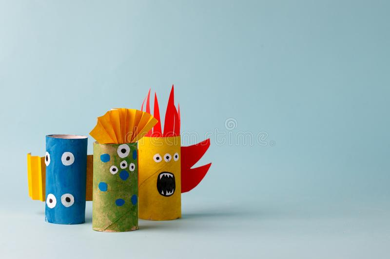 Paper toy ghost, bat, monsters for Halloween party. Easy crafts for kids on blue background, copy space, die creative idea from stock photography