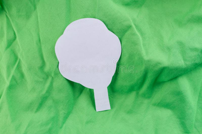 paper tree on green background stock photo