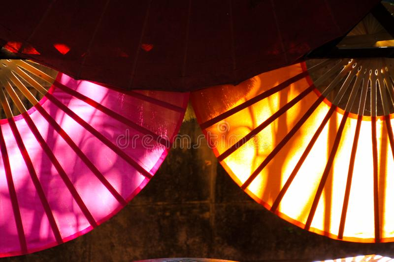 Paper umbrellas illuminated by sun from the back in Chiang Mai, Thailand royalty free stock photos